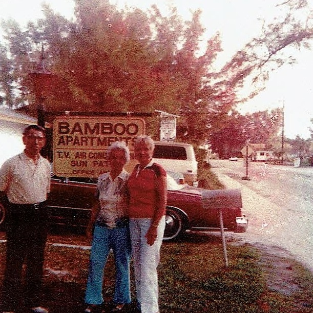 Carmen and Avelino Torres in front of the sign in 1971